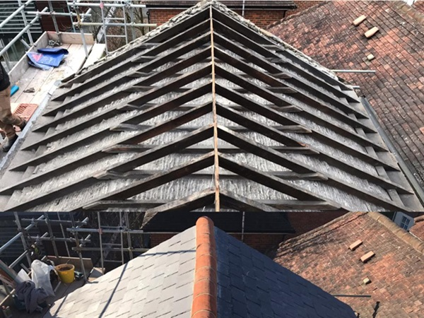 Re-slating roofs in London