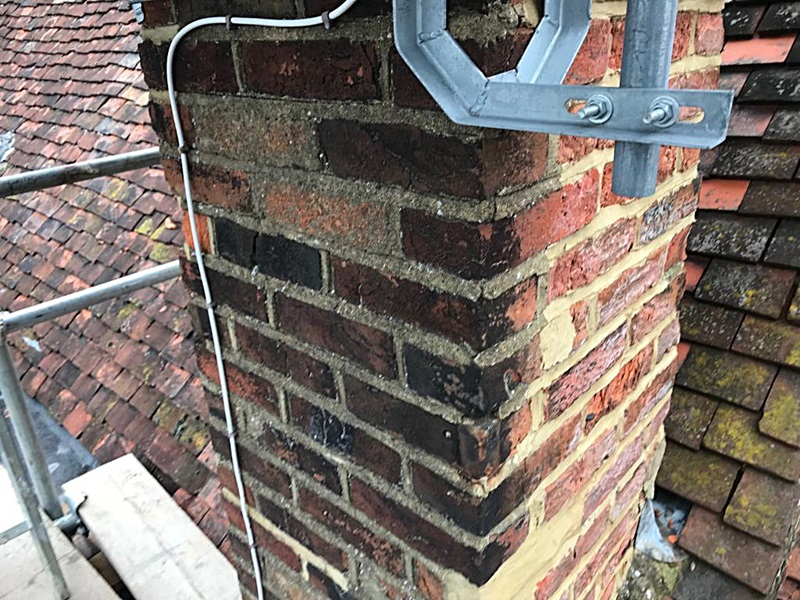 Chimney repairs with reclaimed bricks